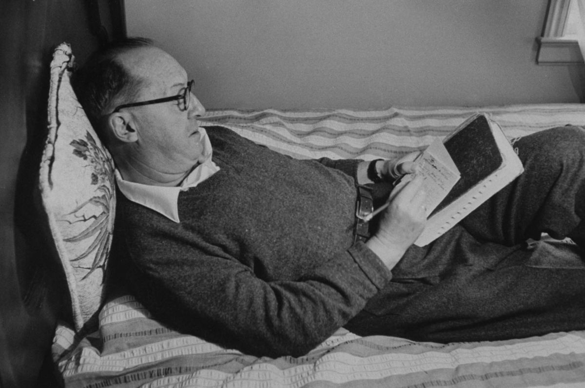 Author Vladimir Nabokov writing in a notebook on the bed. (Photo by Carl Mydans//Time Life Pictures/Getty Images)